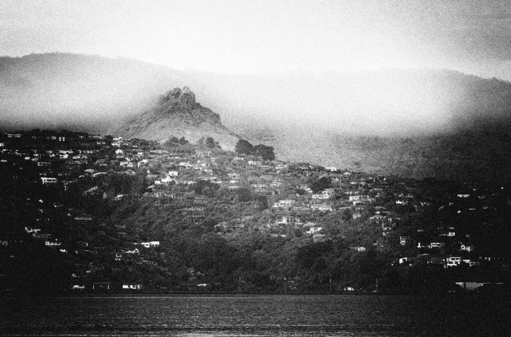 A hillside landscape black & white image with lots of grain